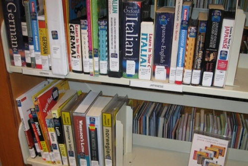 Shelves of books and CDs for language learners.  Materials shown are for German, Italian, Japanese, Korean, Latin, Mixteco, and Norwegian languages.