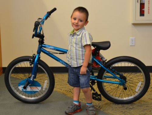Ciro Raygoza, 3, is the proud recipient of a Mongoose bike donated by the Mount Vernon Wal-Mart.